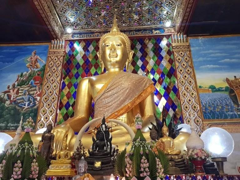 Golden Buddha statue in temple Wat Ku Kut Wat Chama Thewi