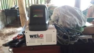 Welding machine and mask