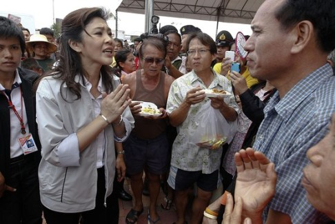 Prime Minister Yingluck Shinawatra Acknowledges her Government Could not Control the Approaching Deluge
