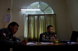 Police Col. Myint Thein, right, head of the Central Committee for Drug Abuse and Control which controls the country's drug policy, and police officer Majo Zaw Min Oo sit in an office in Yangon, Myanmar.