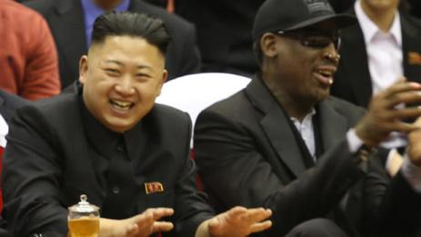 North Korean leader Kim Jong Un, left, and former NBA star Dennis Rodman watch North Korean and U.S. players in an exhibition basketball game at an arena in Pyongyang, North Korea