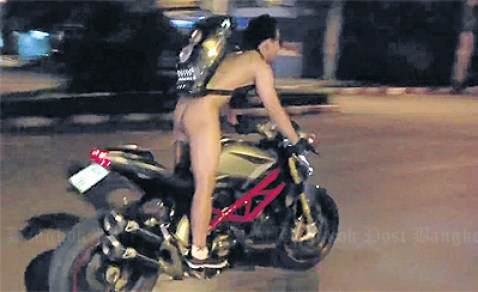 A naked Jetpol roars through the streets of downtown Chiang Mai.