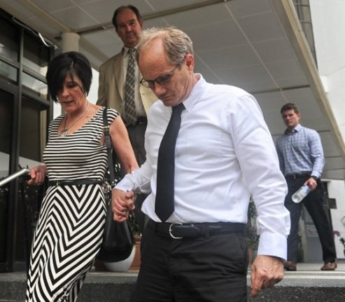 Rick Todd (right) and his wife Mary walk out of the Subordinate courts in Singapore on Tuesday.