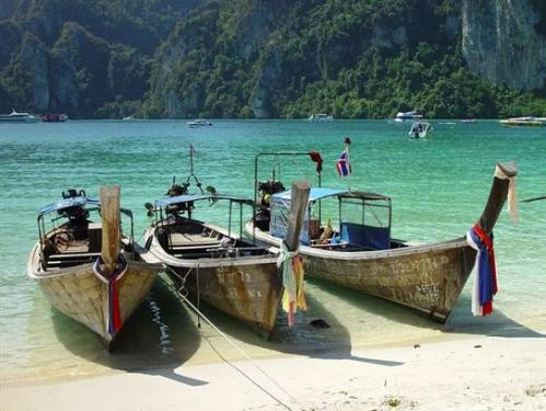 """""""long-tailed"""" boats for hire to foreign tourists at Pipi Islands"""
