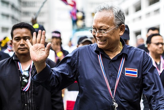 Suthep Thaugsuban, protest leader and former Deputy Prime Minister, acknowledges the crowd at the Democracy Monument in central Bangkok