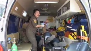 Rescue worker helps bomb victum in Bangkok