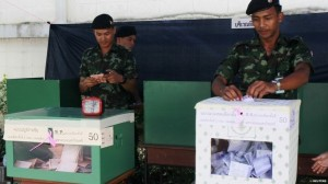 Thai soldiers cast their ballots at a polling station in Bangkok Thai soldiers were among those casting their votes on Sunday.