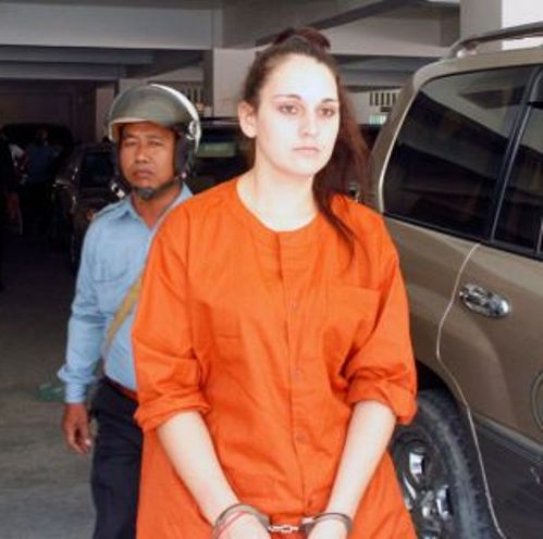French national Charlene Savarino leaves Phnom Penh Municipal Court yesterday after being tried on drug-trafficking charges