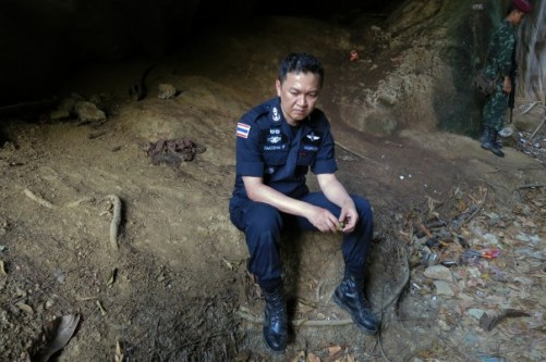 Police Major General Thatchai Pitaneelaboot rests during a trek through a forest to locate a trafficking camp in Satun, southern Thailand March 27, 2014. Thatchai is leading a campaign against human trafficking in the region.