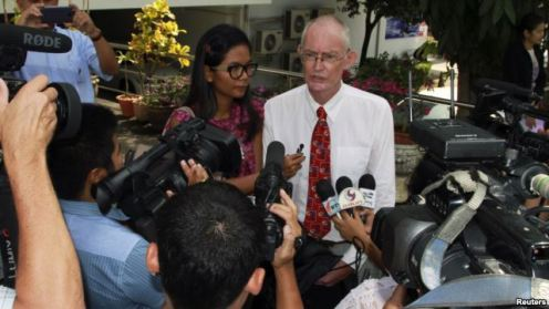 Alan Morison (R), an Australian, and Thai national Chutima Sidasathian, reporters for the Phuketwan news website, speak to media as they arrive to a criminal court in Phuket