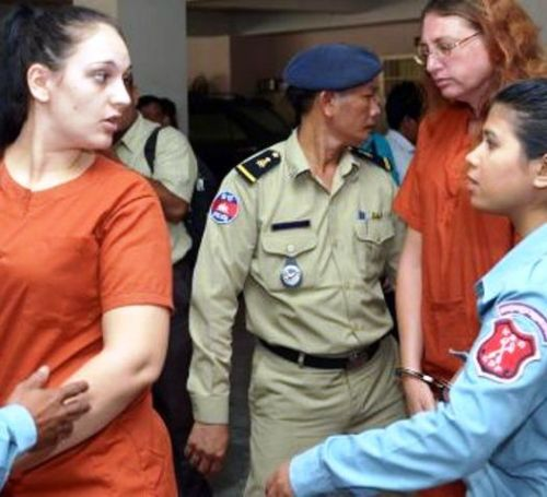Frenchwoman Charlene Savarino (left) and Australian Yoshe Ann Taylor (right) are escorted by guards at Phnom Penh Municipal Court yesterday after being sentenced for attempting to smuggle heroin to Australia.