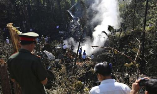 Rescue workers search the air force plane crash site in Xiangkhouang province, Laos. Photograph: Reuters