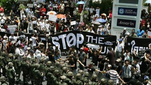 Thai armed soldiers stand guard as the pro-democracy activists hold a demonstration against the military coup in Bangkok