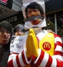 Protesters against military rule wear masks of Sombat Boonngamanong,