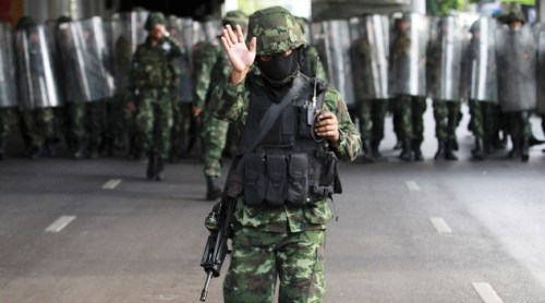 Thai soldiers move in to secure the Victory Monument square to bar protesters from staging anti-coup demonstration in Bangkok, Thailand