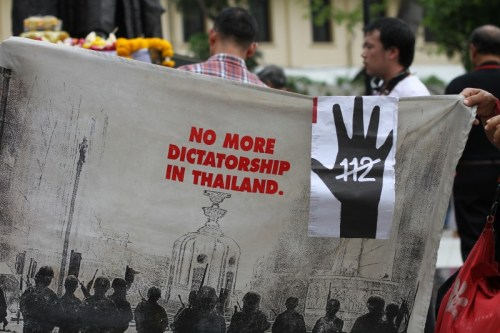 Protesters hold up a banner demanding a reform in Article 112 or the Lese Majeste (anti-royal insult) law.