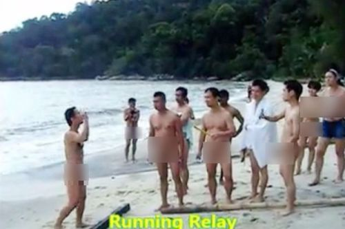 The nudists participants ready for a relay race as seen on five minute video.