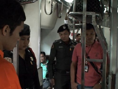 Police officers investigating the reported theft on Southbound Express Train no. 37, 5 August 2014