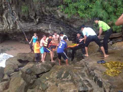 Rescue workers recover the bodies of two Indians that drowned