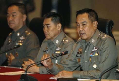 Chief of Royal Thai Police General Somyot Poompanmuang (R) speaks during a news conference at  the Royal Thai Police headquarters in Bangkok