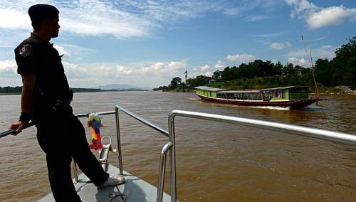 Thai Marine Border Police patroling along the Mekong river, which marks the border between Thailand and Laos