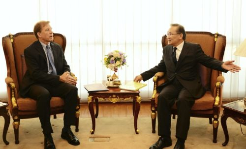 W. Patrick Murphy, left, talks with Thai Deputy Foreign Minister Don Pramudwi