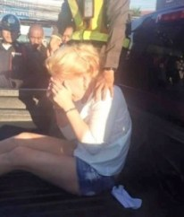The woman, a blonde named Samantha, 29, had to be saved by quick-thinking police as a mob gathered on the street, incensed by the chaos and damage she had caused.