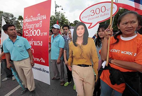 Yingluck's Pheu Thai Party Adopts Nationwide Minimum Wage Policy Amid Controversy