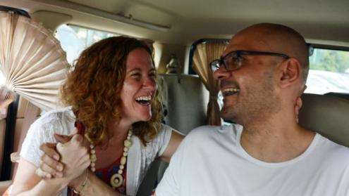 Canadian school administrator Neil Bantleman (R) is reunited with his wife Tracy Bantleman
