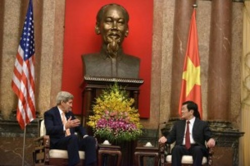 U.S. Secretary of State John Kerry, left, and Vietnamese President Truong Tan Sang talks during a meeting at the Presidential Palace in Hanoi, Vietnam