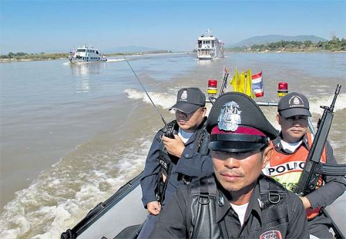 Thai Marine Border Police patrol the Mekong river in Chiang Saen in northern Chiang Rai province in May, 2013.
