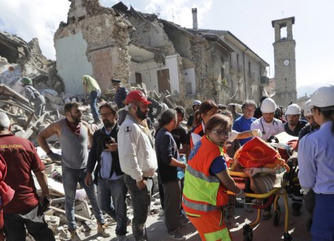 A victim is pulled out of the rubble following an earthquake in Amatrice Italy.