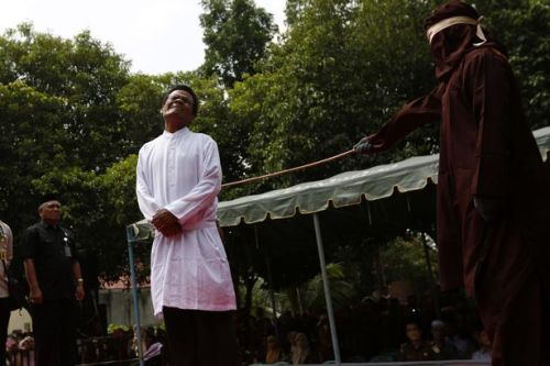 Indonesian Woman Publicly Flogged for Being too Close to a Man