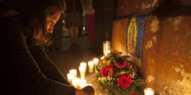 A woman lights a candle during a vigil in remembrance of the victims of a fire at a children's shelter, outside the morgue where the bodies are being identified in Guatemala City, Wednesday, March 8, 2017. Authorities say at least 22 girls have died after a fire at the children's shelter Virgin of the Assumption Safe Home, which was created to house children who were victims of abuse, homelessness or who had completed sentences at youth detention centers and had nowhere else to go. (AP Photo/Moises Castillo) Guatemala Fire