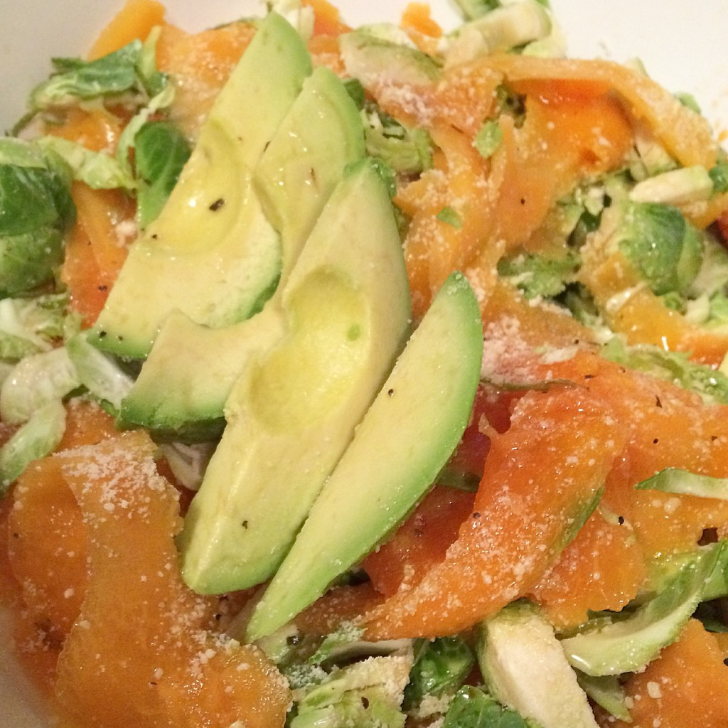 The Perfect Summer Salad = Brussel Sprouts Salad topped with Papaya, Parmesan Cheese and Avocado