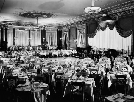 Interior view of the Empire Room, showing tables and chairs in correct positions, an event space inside the Palmer House hotel, in Chicago, Illinois, circa June 4-8, 1936.