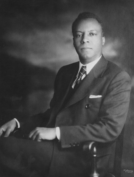 Seated black and white portrait of A. Philip Randolph