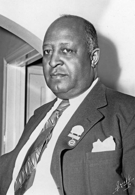 Half portrait photograph of Milton P. Webster