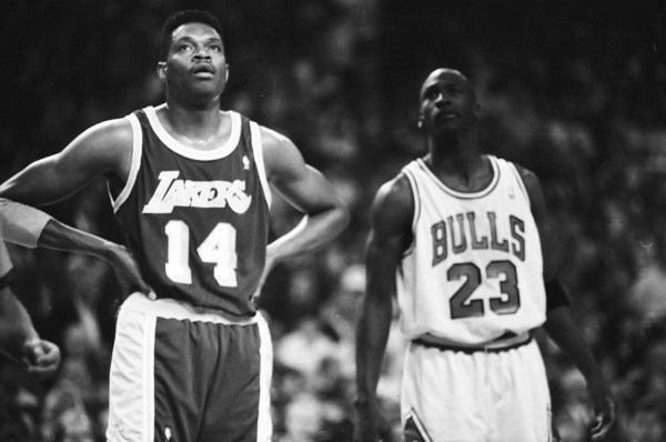 Sam Perkins and Michael Jordan stand next to each other during the game