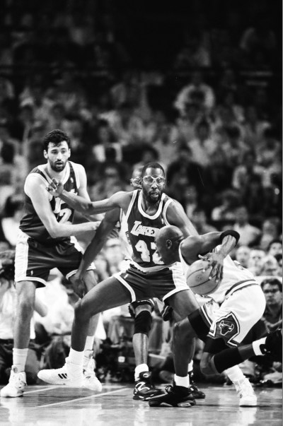 Michael Jordan with the ball being defended by James Worthy