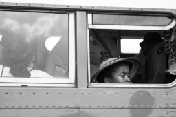 A young girl sits on the Montgomery City Lines bus, a replica of the bus that Rosa Parks rode in 1955. Many who attended the 50th Anniversary March on Washington took time to visit the bus. Photo by Sophia Nahli Allison.