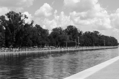 A large crowd gathers around the Lincoln Memorial Reflecting Pool. Photo by Sophia Nahli Allison.