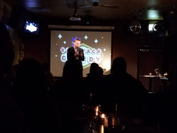 Blake Burkhart performing stand-up comedy at Holiday Club