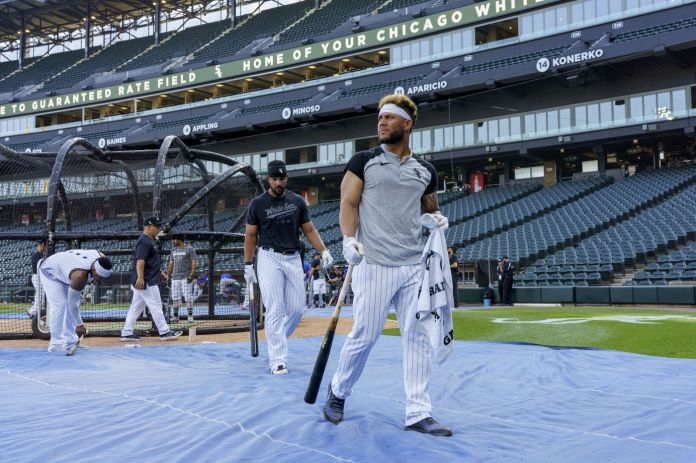 Chicago White Sox first baseman Jose Abreu, middle, and third baseman Yoan Moncada walk off the field after warming up before playing the Toronto Blue Jays at Guaranteed Rate Field on June 8, 2021.