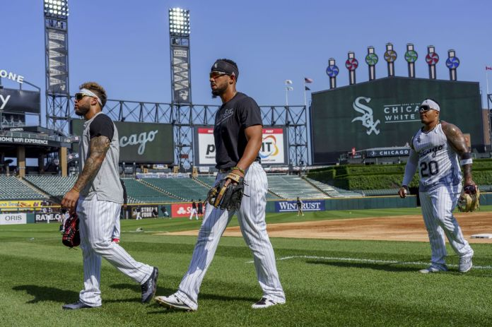 Chicago White Sox third baseman Yoan Moncada, left, first baseman Jose Abreu and designated hitter Yermin Mercedes warm up before playing the Toronto Blue Jays at Guaranteed Rate Field on June 8, 2021.