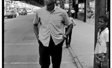 Ali standing on 63rd Street in the Woodlawn community.