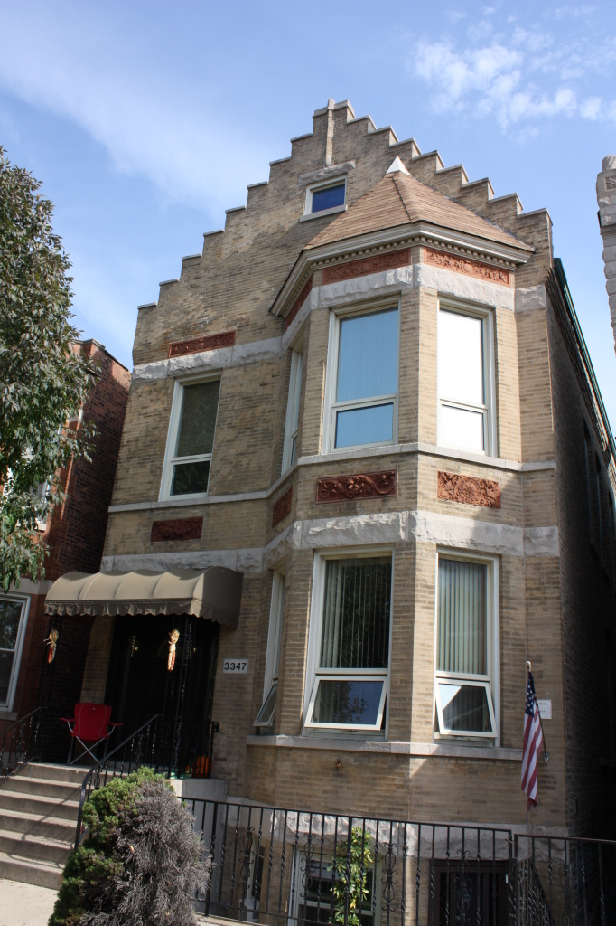 Stepped gable boomtown front on a two-flat on the 3300 block of South Union