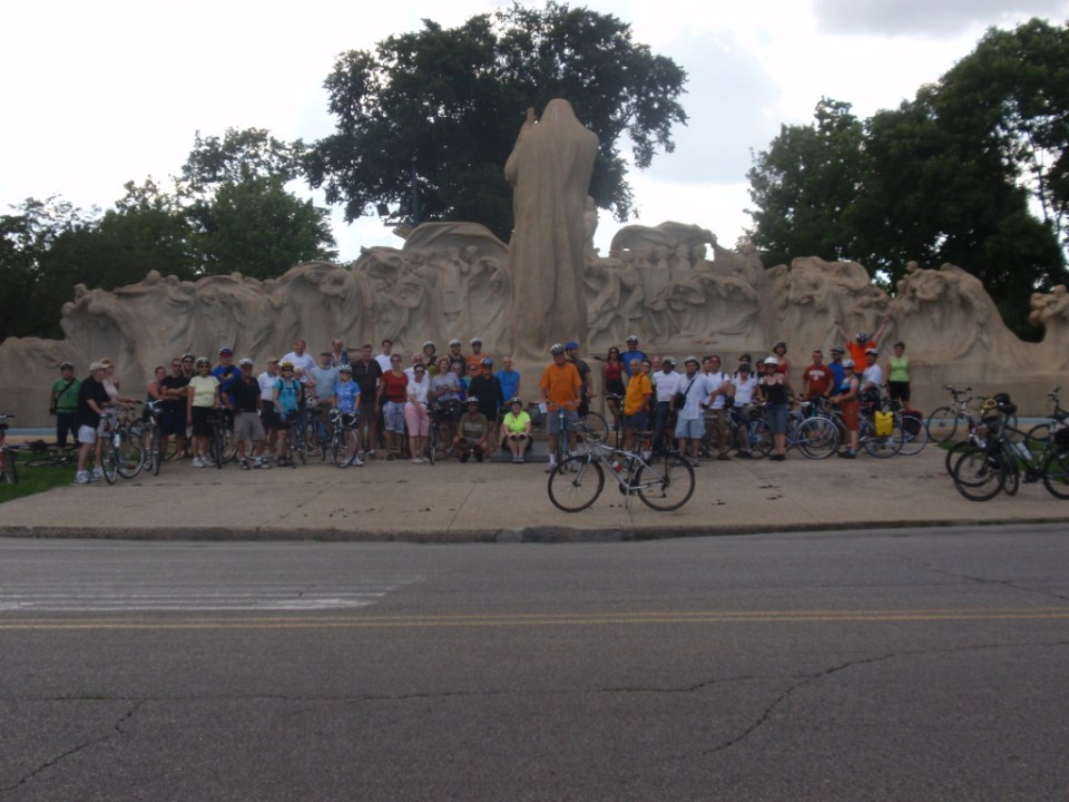 Tour of Hyde Park riders in front of the Fountain of Time
