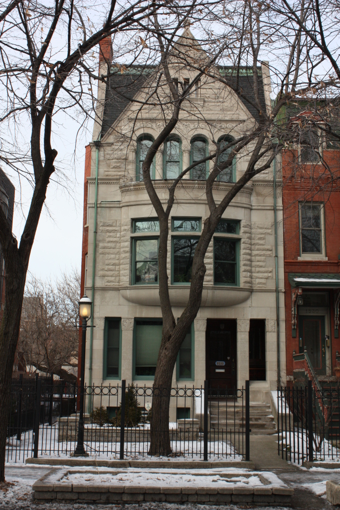 Richard Norman Foster House at 1532 W Jackson Blvd is a limestone Romanesque townhouse built in 1892 by Patton and Fisher.