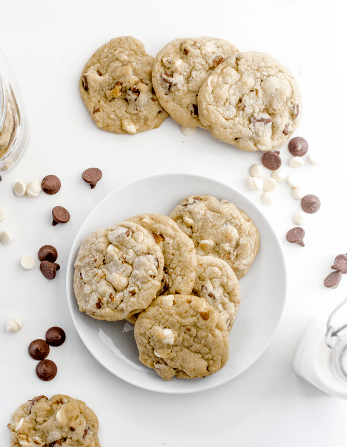 These chocolate chip cookies are inspired by those made at Castle Hill Inn in Newport, RI. They are thick, soft and full of chocolate chips and pecans. Pure heaven for chocolate chip cookie lovers. | www.chicandsugar.com